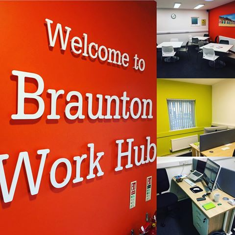 Welcome to Braunton Work Hub on orange wall, collage of photos of offices painted in bright colours